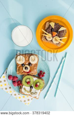 Funny Breakfast Toast For Kids Shaped As Cute Cat, Dog, Bear, Fish. Food Art Sandwich For Child. Iso