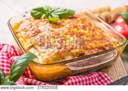 Traditional Italian Lasagna With Vegetables, Basil, Minced Beef Meat, Tomato And Cheese On Wooden  B