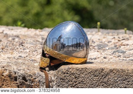 Afula, Israel, July 18, 2020 : The Knights Helmet Lies On The Stones In The Ruins Of The Great Hospi
