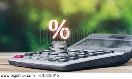 Coins Stacked On The Calculator And Has An Illustration Of Interest Concept Of Calculating Interest