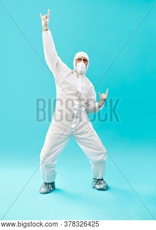 Full Lenght Portrait Of Happy Doctor In Ppe Suit Celebrating His Success With Winner Gesture And Han