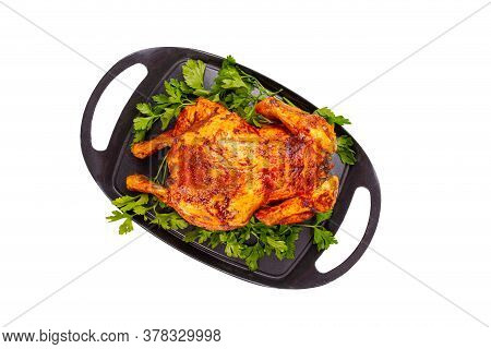 Flat Lay Of Oven Baked Whole Chicken On Iron Plate, White Background