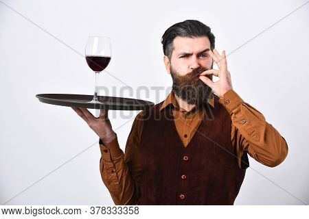 Barman With Satisfied Face Holds Alcoholic Drink
