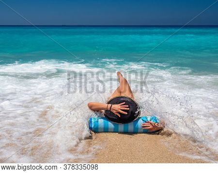 Woman on a inflatable at the beach in Greece
