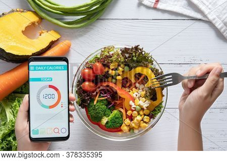 Calories Counting , Diet , Food Control And Weight Loss Concept. Calorie Counter Application On Smar
