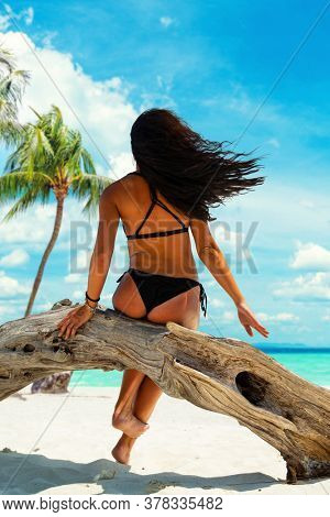 Sexy young woman enjoying her holidays on a tropical beach