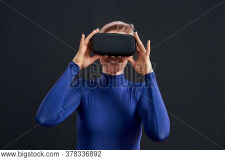 Woman With Short Hair In Blue Turtleneck Wearing Virtual Reality Headset, Vr Glasses Isolated Over D