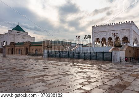 The Mausoleum Of Mohammed V, A Historical Building Located On The Opposite Side Of The Hassan Tower