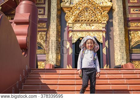 Chiang Mai, Thailand - Dec 25, 2019 : Little Child Girl Or Little Tourist Walking Down The Stair At