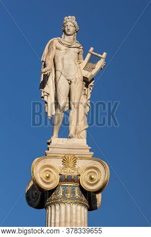 Athens, Greece - January 19,  2017: Apollo Statue In Front Of Academy Of Athens, Attica, Greece
