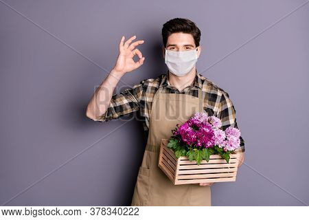 Portrait Of His He Nice Healthy Guy Gardener Wearing Safety Mask Holding In Hands Flowers Pot Stop I