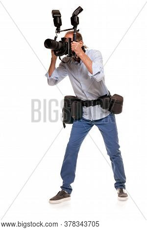 Full Portrait Of Male Journalist Working With Digital Professional Camera