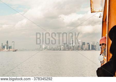 New York City, Usa - February 11, 2020: Woman Passenger Standing On Deck Of Staten Island Ferry. Fam