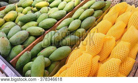 Pile Of Mango Barracuda And Green Mango At Market.
