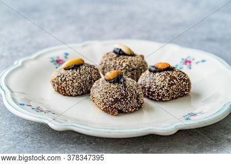 Traditional Turkish Dessert Balbadem / Bal Badem Also Called Chocolate Sekerpare With White Poppy Se