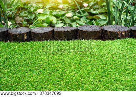 Artificial Turf Background. Landscape Design With Using Of The Soft Artificial Grass.