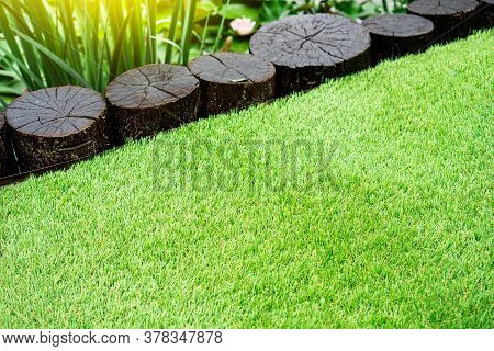 Perfect Soft Artificial Grass Behind The Decorative Pond With Water Lilies
