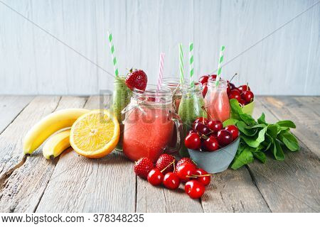 Natural Smoothie Background. Summer Fresh Smoothies Assortment On The Wooden Table.