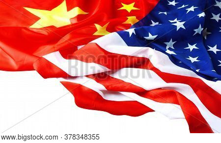 Usa Flag With China Flag Isolated On White. Chinese Flag And American Flag On The Wooden Table.