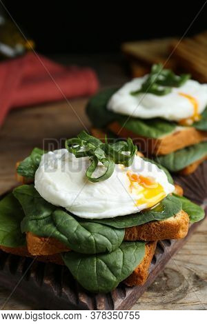 Delicious Poached Egg Sandwiches Served On Wooden Board