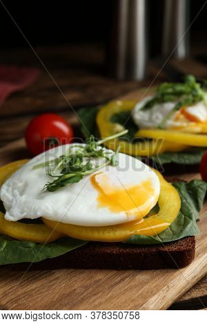 Delicious Poached Egg Sandwich Served On Wooden Board, Closeup