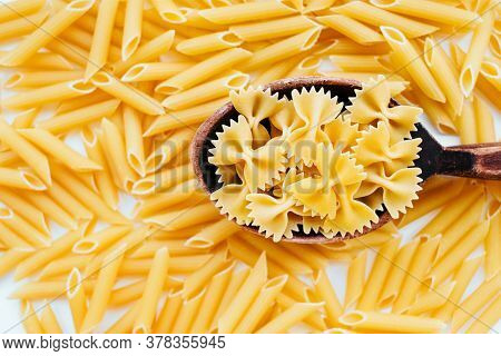 Flatlay With Traditional Italian Raw Farfalle And Penne Pasta Isolated On White Backgroung.