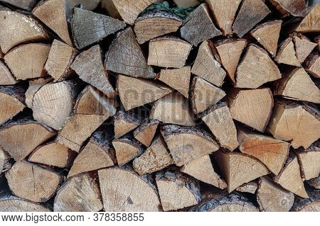Stack Of Firewood. The Firewood Is Neatly Stacked. High Quality Photo