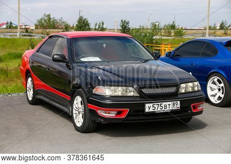 Novyy Urengoy, Russia - July 4, 2020: Black And Red Saloon Car Toyota Mark Ii Tourer V (x100) In The