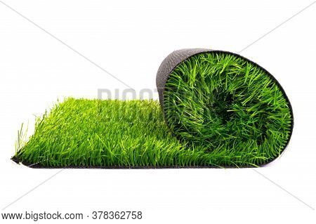 Artificial Turf Roll Of Green Grass Isolated On White Background .