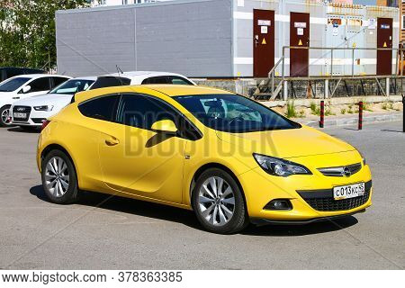 Novyy Urengoy, Russia - July 6, 2020: Bright Yellow Car Opel Astra J Gtc In The City Street.