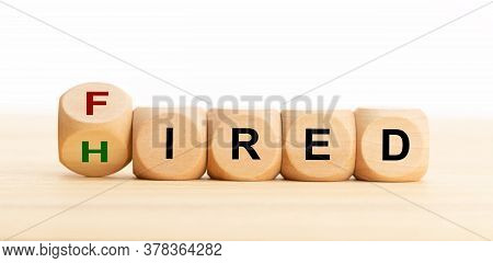 Fired Hired Concept. Wooden Blocks With Text On Table. Employment Or Business Concept. Copy Space