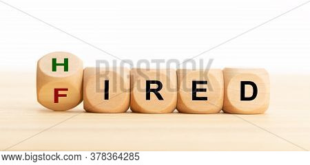 Hired Fired Concept. Wooden Blocks With Text On Table. Employment Or Business Concept. Copy Space