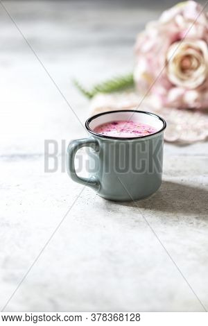 Ayurvedic Rose Moon Milk. A Trendy Relaxing Form Of Drink Before Bed. Milk With Rose Petals In A Gra