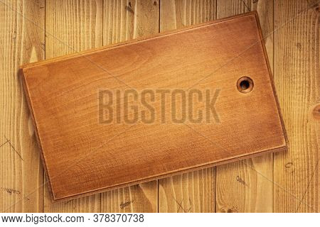 cutting board or tray at wooden background texture, top view