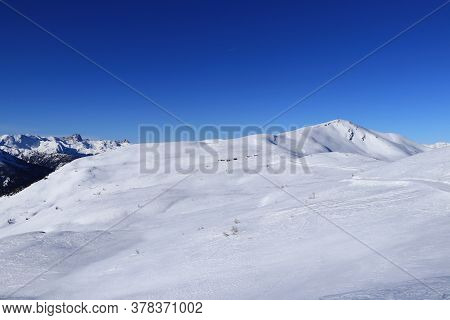 View On Freeride In Obertilliach Ski Resort From Golzentipp Mountain To Gripp Mountain And Down To R
