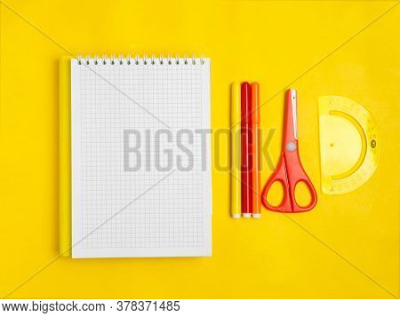School Supplies On An Orange Background. School Concept, Office Supplies. A Copy Of This Place.
