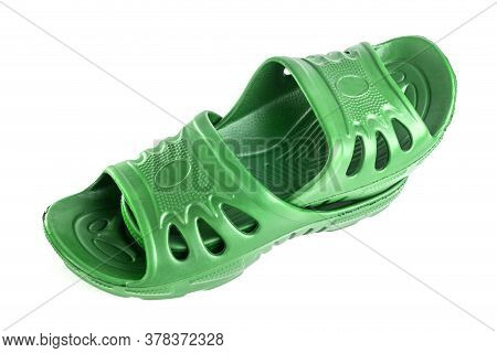 Pair Of Cheap Durable Green Rubber Slippers One Inside Other Isolated On White Background.
