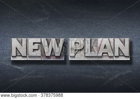 New Plan Phrase Made From Metallic Letterpress On Dark Jeans Background