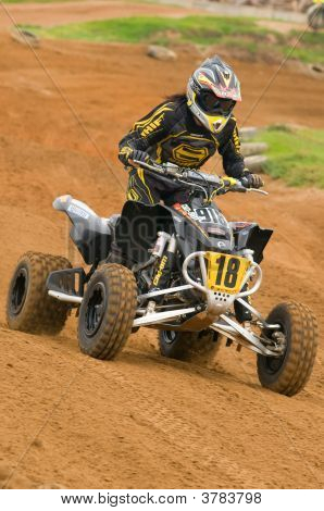 Atv Motocross Rider On The Charge