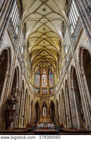 Prague - March 10, 2020: Interior Of St. Vitus Cathedral In Prague. Main Nave And Stained-glass Wind