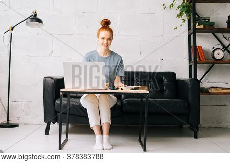 Happy Redhead Young Woman Student Noting Into Workbook Important Information From Book In Preparatio