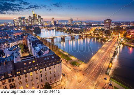 Frankfurt, Germany skyline over the Main River at dusk.
