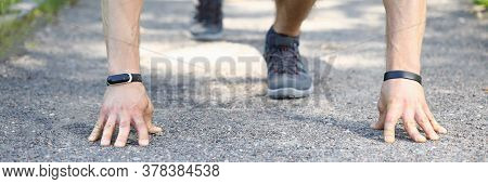 Close-up Of Professional Athlete Preparing For Run In Park. Man In Comfy Stylish Grey Sneakers In Po