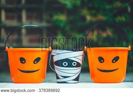 Child Trick Or Treat Empty Halloween Buckets Are Ready For The Candy Treats, Jack-o-lantern Pumpkin