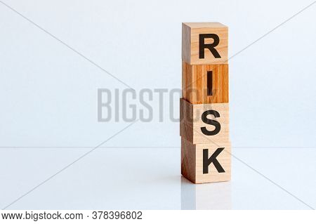 Risk Cube Wooden Blocks On White Table Background. Home, Crisis, Economic Recession, Buy Concept. Fr