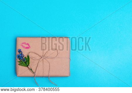 Gift Box And A Posy Of Lavenderand Kisses On Blue Background