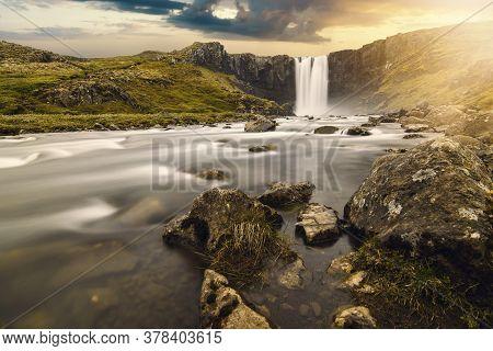 Sunset Over Gufufoss Waterfall In Iceland Eastfjords Seydisfjordur Village