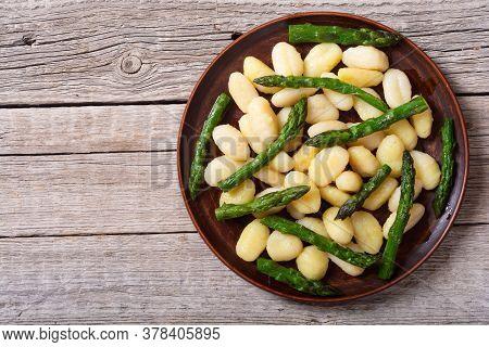 Italian Homemade Potatoes Gnocchi With Asparagus