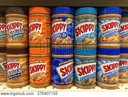 Alameda, Ca - July 14, 2020: Grocery Store Shelf With Jars Of Skippy Brand Peanut Butter In Various
