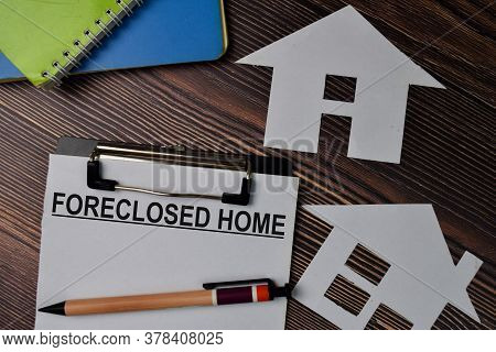 Foreclosed Home Text Write On Paperwork Isolated On Office Desk.